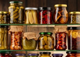 Assorted pickled food in jars
